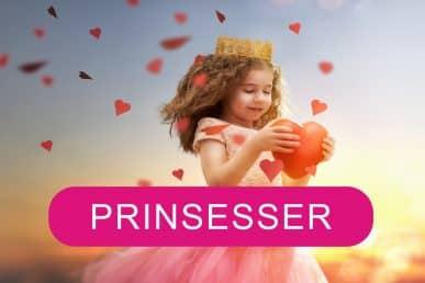 Barn som prinsesse der holder et rødt hjerte