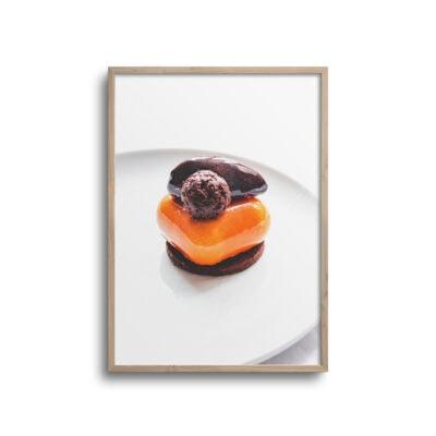plakat af orange kage på en tallerken